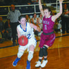 THE DRIVE: Marlow's Molly Koons slips by a Tuttle defender in the Lady Outlaws' win last Friday night.