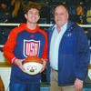 GREAT CAREER: Marlow coach Kirk Harris presented a basketball to senior Dawson Huddleston in recognition of his 1,867 career points he had going into the district tournament game against Lexington last Friday night.