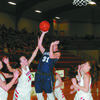 SURROUNDED: Marlow's Lauren Wade gets a shot off under heavy pressure from Washington in their regional tournament game last Friday night.