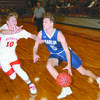 DRIVING AROUND: Marlow's Dawson Huddleston attempts to get by Washington's Kade Hendrix in their semifinal regional tournament game last Friday. Marlow won the game, 53-47.
