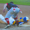 CLOSE PLAY: Central High's Landon Burton gets called out trying to dive back to first base in the Bronchos' game against Vanoss at the Central High Spring Festival last Friday.