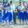 HOME RUN: Central High's Katelynn Vandever is greeted at home by teammates after hitting a home run against Geronimo at the district tournament last Thursday.