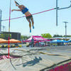 FLYING HIGH: Central High's Destyne Robbins clears the bar at the Class A State Meet to win the pole vault state title.