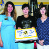 RETIRING: K Kay Alsobrook shows her retirement cake with her daughter, Kim Way, and sister, Donita Campbell, at the end of the year luncheon at Central High last Thursday. Alsobrook taught at the school for 43 years, teaching 17 different subjects.