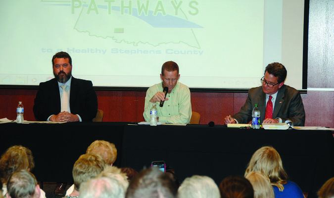 MARIJUANA FORUM: Dr. Matt Ivory (center) talks as Bud Scott of New Health Solutions (left) and District Attorney Jason Hicks listen during the SQ 788 Public Forum held in front of an overflow crowd at the DRH Pavilion on Tuesday night.