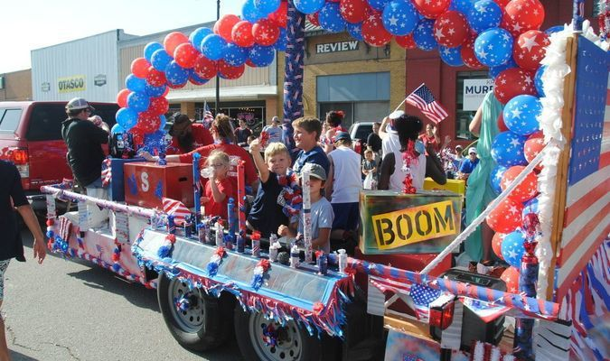 WINNING FLOAT: Children throw candy from the Gregston's Nursing Home float at the 4th of July parade last Wednesday. The entry won first place in the float contest.
