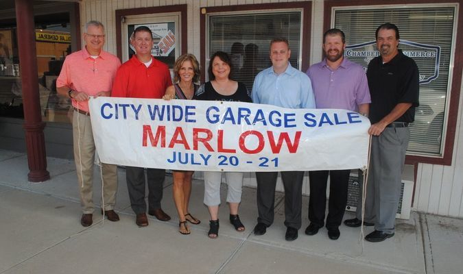 Marlow Chamber of Commerce board members promote  the City Wide Garage Sale being held July 20-21 in Marlow