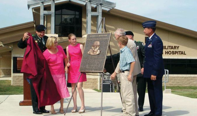 UNVEILING: The plaque naming the war dog hospital in memory of former Marlow graduate Daniel Holland is revealed to his family in 2009.