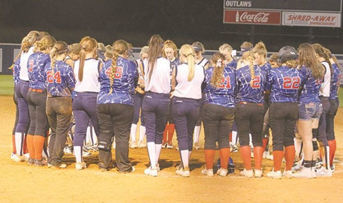 UNITY: Marlow and Bray-Doyle softball players have a post-game prayer around the pitcher's mound following their summer league game last week.