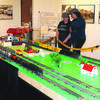"Bailey Teakell, CTHC intern, and Callie Williams talk about the ""Railroads in Oklahoma"" display"