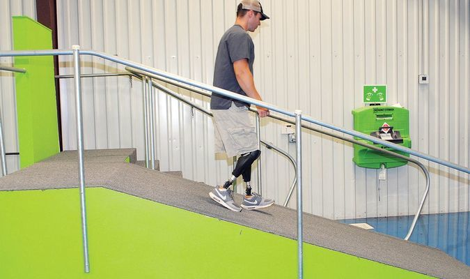 NO HANDS: Dream Team Prosthetics employee Seth Alexander makes use of the technological advances made in the industry by walking down an incline without the assistance of a handrail.