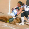 BEATING THE THROW: Bray-Doyle's Kaily Early steals home in a game Monday.
