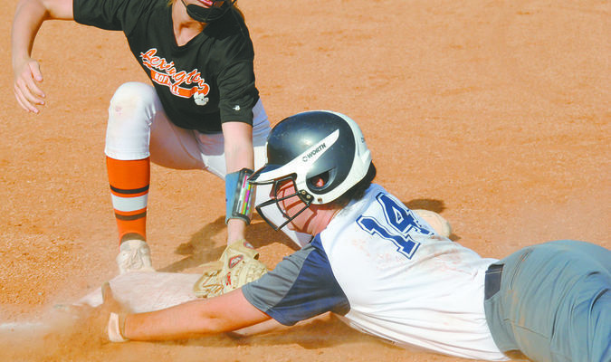 BACK SAFELY: Marlow's Lauren Wade beats the tag of the Lexington third baseman as she dives back to the bag in the Lady Outlaws' 7-6 win over Lexington on Monday.