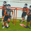 ON THE MOVE: Marlow linemen go through a chute drill on the first day of practice Monday afternoon.