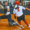 PLAY AT THE PLATE: Marlow catcher Aurelia Holguin prepares to tag out Jayden Abbot of Rush Springs in a bang-bang play as the Lady Redskins tried a double steal of second and home plates.