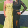 Marlow's Blair Brantley and Idabel's Neriah Wherry stand together after being crowned 2018 All-State football game homecoming queens
