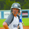 ALL SMILES: Carlie Payne looks at Marlow head coach Brian Miller after safely making it to third base in the Lady Outlaws' win over the Lady Indians last Thursday.