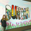 FINISHED PROJECT: Alyssa Cox of Marlow stands beside the mural she painted for a business at the mall in Duncan.