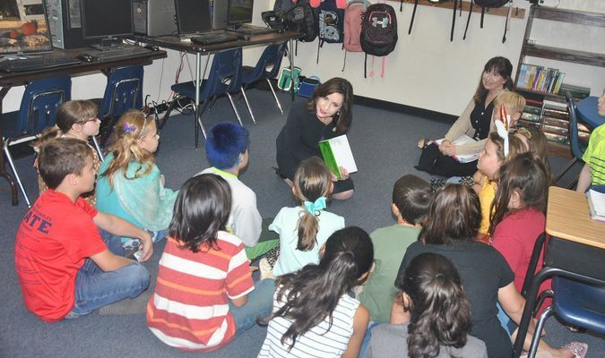 State superintendent Joy Hofmeister reads to Mrs. Thornton's third grade class at Central High.