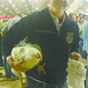 PRIZE CHICKEN: Cameron Freeman of Marlow holds one of his broilers that helped him win third place overall and collect $500 at the Tulsa State Fair.
