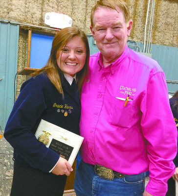 TOP EARNER: Central High FFA's Gracie Harris 2017 High Meat salesperson receiving her award from FFA advisor RJ Curry at last year's Central High FFA Labor Auction