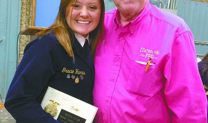 TOP EARNER: Central High FFA's Gracie Harris 2017 High Meat salespersonreceivingher award from FFA advisor RJ Curry at last year's Central High FFA Labor Auction