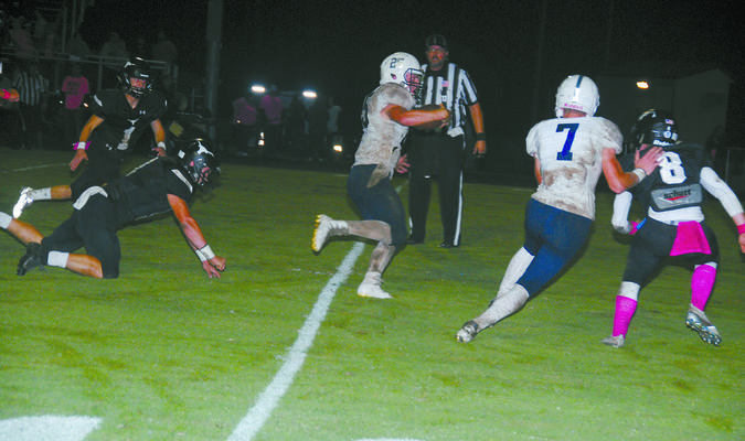ON THE MOVE: Marlow running back Sam Ivory picks up a big gain on his way to finishing with 155 yards and two touchdowns at Lone Grove in the Outlaws' win last Friday.