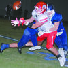 JARRING HIT: Marlow defensive back Nolan Herchock delivers a blow at the perfect time to prevent a catch by a Sulphur receiver last Friday night. Sulphur won the game, 42-7.