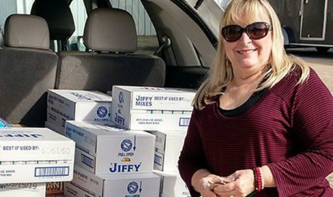 CHRISTMAS BOXES: On Monday, Nov. 26, the Marlow Samaritans will begin taking applications for their annual food distribution held in December. Shown above, Terrie Keck, of the Marlow Association of Classroom Teachers, is delivering 275 boxes of cornbread mix to the Marlow pantry. The mixes will be added to the boxes that will be handed out on Dec. 15th.