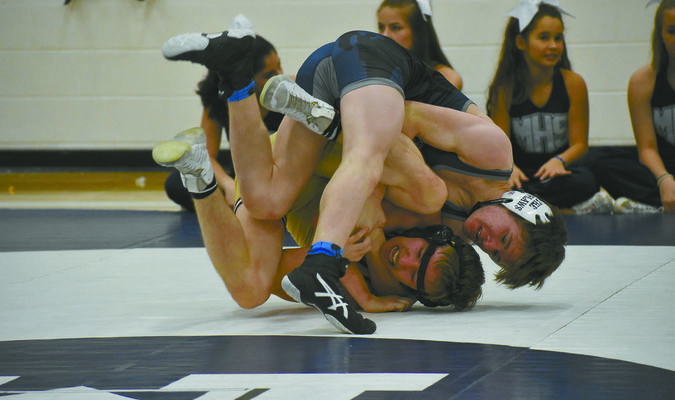 : Marlow wrestler Kyle Davis (top) tries to secure a cradle move in his 132-pound match against Nik Gers at Marlow's dual meet opener against Blanchard on Tuesday. Davis would go on to win by pin.