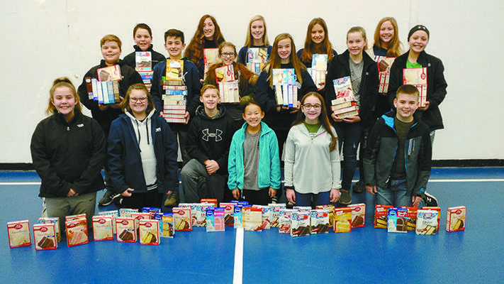 GIVING A HAND: Marlow's Middle School Student Council gathered 268 cake mixes for the upcoming Samaritan Christmas box distribution set for Saturday.