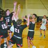 HEAVY TRAFFIC: Marlow's Junior Marroquin gets lost among four Pauls Valley defenders as he shoots in the Outlaws' win over the Panthers on Tuesday.