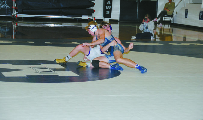 Marlow's Jayden Absher gets the upper hand on his Chickasha opponent.