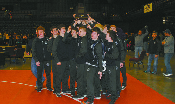 BACK AGAIN: Marlow wrestlers celebrate finishing as state runner-up at last year's Dual State meet.