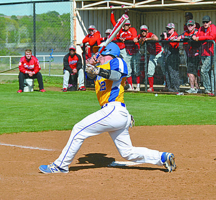 Bryson Johnson digs for a single in the first inning of district play against Empire. Photo by Harper Pitts