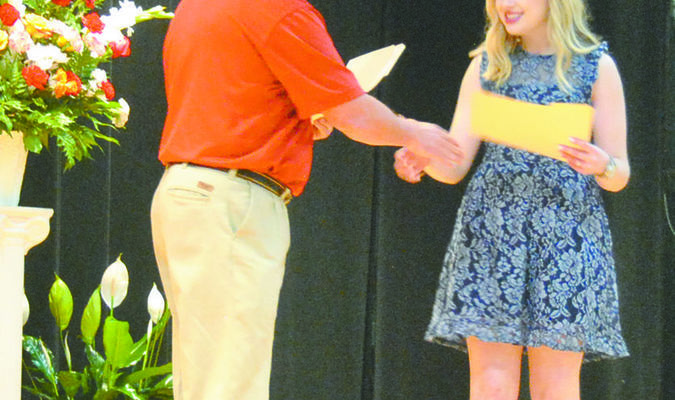 Jerome McCalvin presents the Marlow Alumni Association scholarship to Lily Smith.  Photo by Elizabeth Pitts-Hibbard