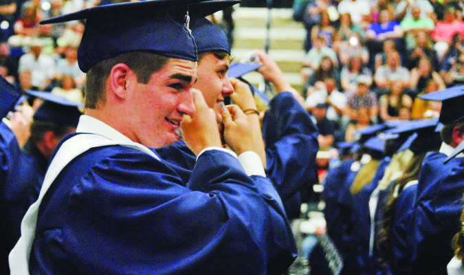 Kobey Kizarr turns his tassel to the left after MHS graduation.  Photo by Elizabeth Pitts-Hibbard