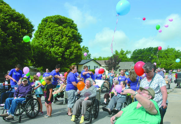 "Residents at Gregston's Nursing and Rehab release balloons to celebrate the annual ""Spring Stroll.""  Photo by Elizabeth Pitts-Hibbard"