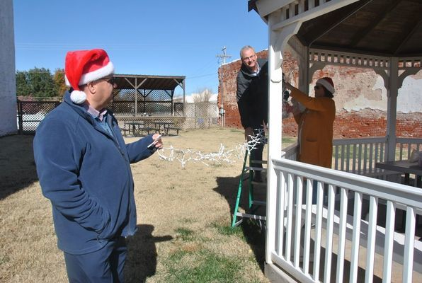 Chamber Board members decorate the gazebo in the park on Main Street for the holidays