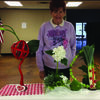 PATIO MEETS: At a recent Patio Garden Club meeting, Mrs. Shirley Johnston, shown above, created three floral designs that can be useful in a dining room or kitchen display.