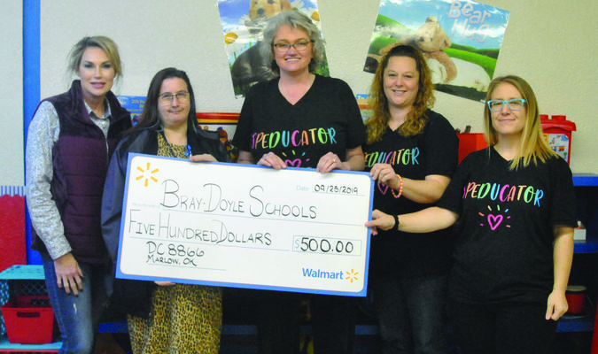 """Brandie's Room: Kim Patterson and Theresa Johnson of Walmart Jewelry Repair Center in Marlow present a donation check to Ann Patterson, Bray-Doyle Special Education teacher, and paraprofessionals Brandie Poston and April Martin. The funds will be used for additional supplies and improvements to """"Brandie's Room,"""" a sensory room at Bray-Doyle school.  Photo by Elizabeth Pitts-Hibbard"""