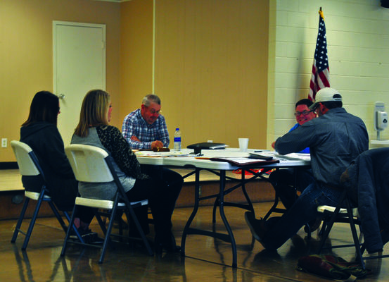 DISTANCING: The Stephens County Commissioners moved their regular meeting to Territory Hall at the Fairgrounds so that attendees could observe social distancing standards, sitting six feet apart while participating.