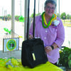 Newly-installed State OHCE President Sandy Pogue receives a congratulatory gift from Stephens County OHCE members on Friday at a drive-through reception.