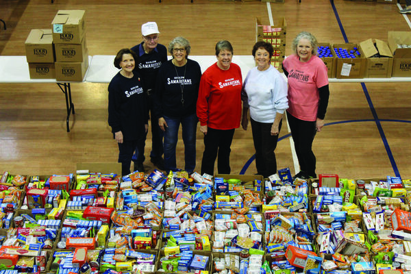 MARLOW SAMARITANS will begin preparing for their annual Christmas food box distribution that will be held on Saturday, Dec. 19th at the First Baptist Church Life Center beginning around 9:30 a.m. Volunteers, (l-r) Hilma Shepard, Virgil Richards, Cricket Holland, Carolyn Lowe, Sue Cramton, and Mary Cobb, will be among those who work to make sure everyone who signed up will receive the food.