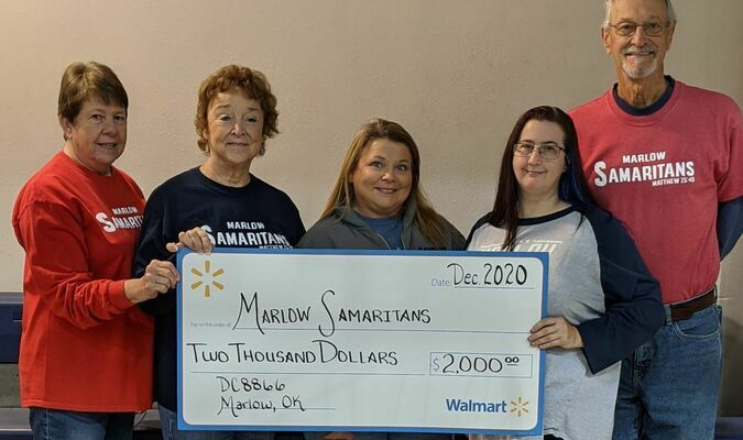 WAL-MART grant of $2,000 was recently presented to the Marlow Samaritans. Shown above accepting the donation are, l-r, Carolyn Lowe, Sue Cramton, Cathy Hamer, Wal-Mart area manager, and Theresa Johnson, Wal-Mart Human Resources coordinator of Wal-Mart Jewelry #8866, and Bobby Cobb.