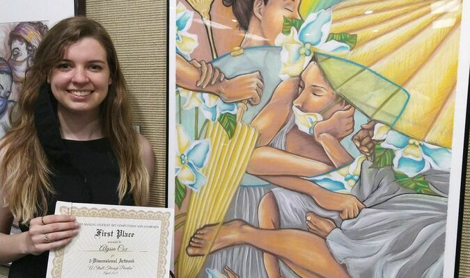 "Cameron student Alyssa Cox displays her first-place award in the Two Dimensional Art category of the Cameron University Student Art Competition alongside her winning pastel, ""A Stroll through Paradise."" Cox is a 2018 graduate of Marlow High School."