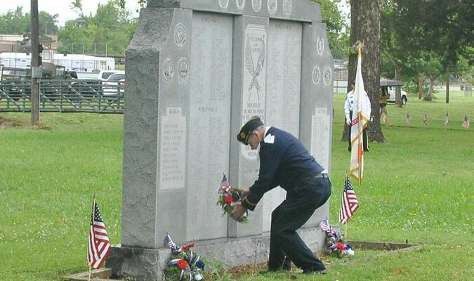 Veteran Larry Davidson places a wreath during the 2020 Memorial Day ceremony at Memorial Park in Duncan.
