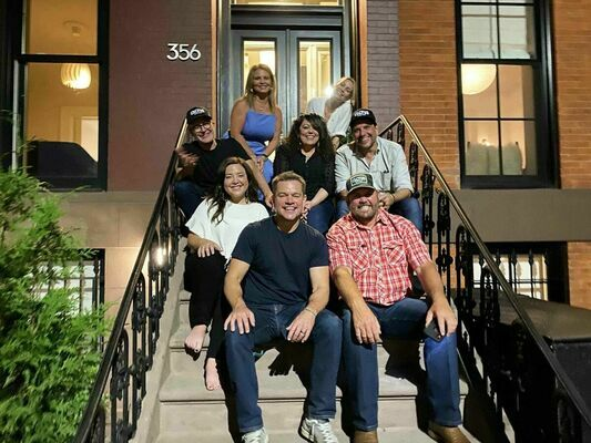 """Kenny Baker and family visited """"Stillwater"""" director Tom McCarthy's home while in New York City for the movie premiere. Front row, from left: Matt Damon, Kenny Baker. Middle: Madison Baker. Third row: Tom McCarthy, Davey Porter, casting director Phil Messina. Back row: Monica Baker, Wendy McCarthy.  Photo courtesy of Kenny Baker"""