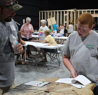 A judge talks to Austin Britt, Ralls County 4-H Member, at the Ralls County Fair.
