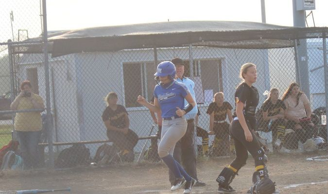 Audrey Ross crosses the plate for the Lady TIgers in the game at Van-Far on September 17.